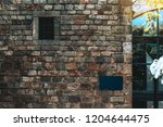 a stone wall of an ancient... | Shutterstock . vector #1204644475