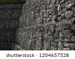 gabions. steel nets filled with ... | Shutterstock . vector #1204657528
