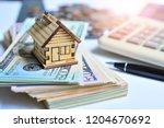 house model on money cash... | Shutterstock . vector #1204670692