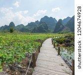 guilin yangshuo mountain range | Shutterstock . vector #1204674928