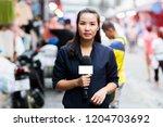 female journalist outside... | Shutterstock . vector #1204703692