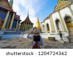 woman tourist is traveling and... | Shutterstock . vector #1204724362