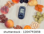 glucometer with result of sugar ... | Shutterstock . vector #1204792858