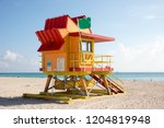 colorful lifeguard tower on... | Shutterstock . vector #1204819948