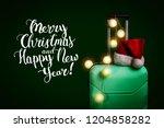 plastic suitcase  santa claus... | Shutterstock . vector #1204858282