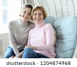 beautiful senior mom and her... | Shutterstock . vector #1204874968