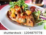 fried ruby fish topped with... | Shutterstock . vector #1204875778