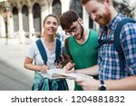 young happy tourists... | Shutterstock . vector #1204881832