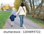 mother and child boy holding... | Shutterstock . vector #1204895722