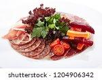 antipasto with sliced ham ... | Shutterstock . vector #1204906342