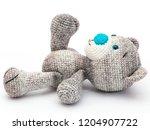 grey crochet teddy bear on... | Shutterstock . vector #1204907722