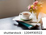 white cup of tea on books with... | Shutterstock . vector #1204930522