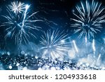 fireworks at new year and copy... | Shutterstock . vector #1204933618