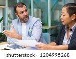 shocked hispanic male manager...   Shutterstock . vector #1204995268