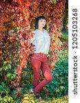 beautiful girl in the autumn... | Shutterstock . vector #1205103268