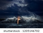 drowning man hand in storm sea... | Shutterstock . vector #1205146702