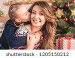 adorable daughter kissing... | Shutterstock . vector #1205150212