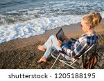 young girl reads in the tablet...   Shutterstock . vector #1205188195