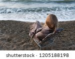 young girl in a plaid sitting...   Shutterstock . vector #1205188198