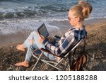 young woman is working with a...   Shutterstock . vector #1205188288