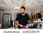 cheerful adult cook in apron...   Shutterstock . vector #1205228275
