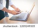 business man using a smart...   Shutterstock . vector #1205249335