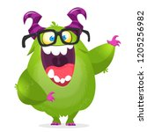 cartoon monster wearing glasses.... | Shutterstock .eps vector #1205256982
