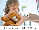 a doctor making a vaccination... | Shutterstock . vector #1205296585