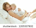 mom and baby  | Shutterstock . vector #1205337832