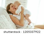 mom and baby  | Shutterstock . vector #1205337922