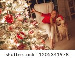 woman at christmas   | Shutterstock . vector #1205341978