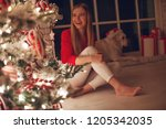 woman at christmas   | Shutterstock . vector #1205342035