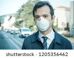 man wearing mask against smog... | Shutterstock . vector #1205356462