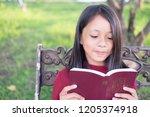 little asian girl reading on...   Shutterstock . vector #1205374918