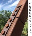 rusted rivets and bolts on a... | Shutterstock . vector #1205394115