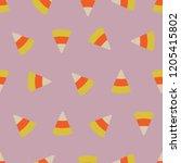 seamless candy corn pattern.... | Shutterstock .eps vector #1205415802