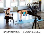 athlete blogger making a video | Shutterstock . vector #1205416162