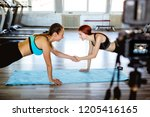 athlete blogger making a video | Shutterstock . vector #1205416165
