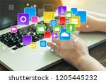 woman working with laptop on... | Shutterstock . vector #1205445232