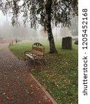 bench in the park. autumn wet... | Shutterstock . vector #1205452168