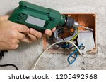 electrician at work with a plant | Shutterstock . vector #1205492968