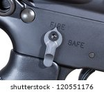 Small photo of Ambidextrous fire controls on an AR rifle ready to fire