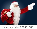 Santa Claus with his magic gift red bag full of presents - stock photo
