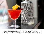 red cocktail with garnish | Shutterstock . vector #1205528722