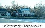the house roof was damaged by... | Shutterstock . vector #1205532325