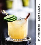 yellow cocktail with garnish | Shutterstock . vector #1205532352