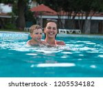 joyful mother with a baby bathe | Shutterstock . vector #1205534182