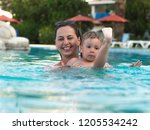 joyful mother with a baby bathe | Shutterstock . vector #1205534242