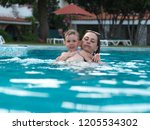 joyful mother with a baby bathe | Shutterstock . vector #1205534302