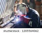 closeup of man wearing mask... | Shutterstock . vector #1205564062